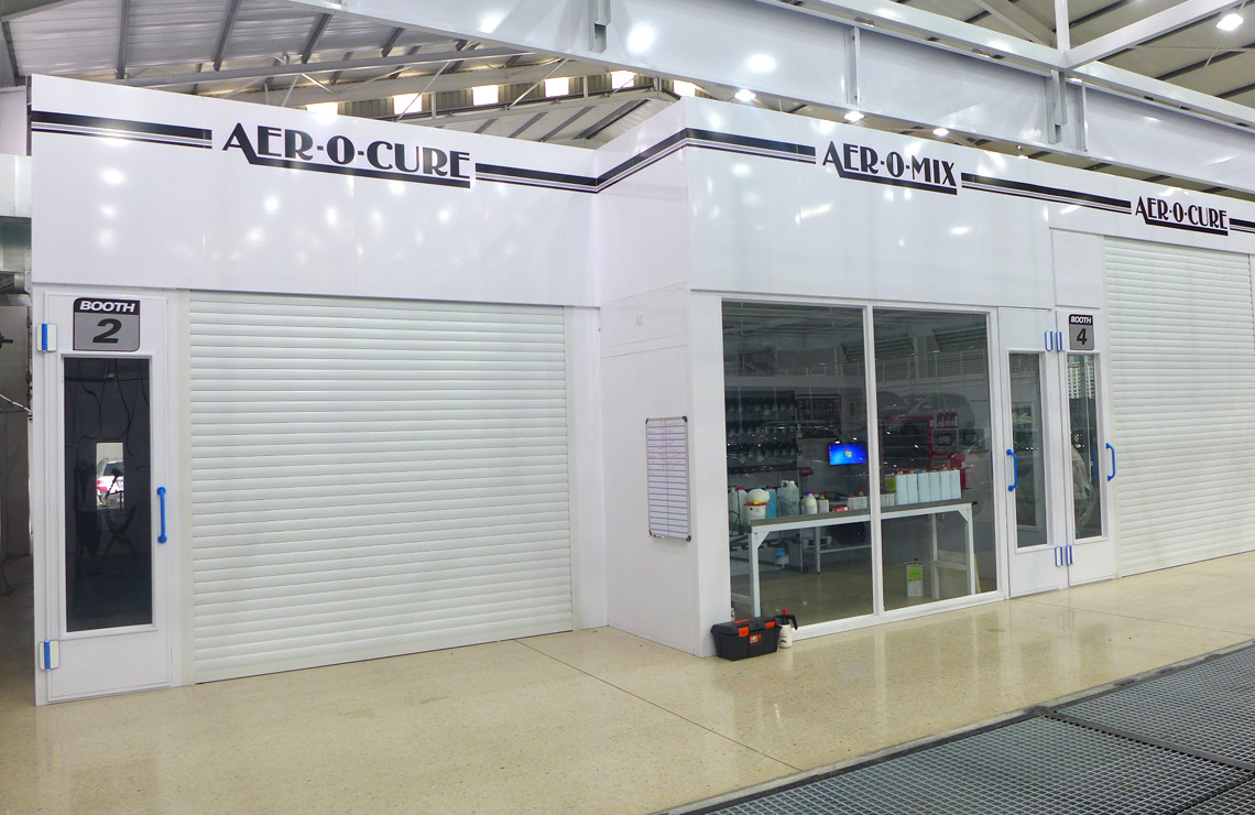 Automatic pressure controlled Aer-o-cure spray booth with roller doors