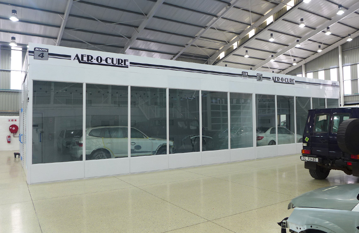 Two in-line drive through Aer-o-cure spray booth ovens, allowing paint shop complete flexibility of workflow