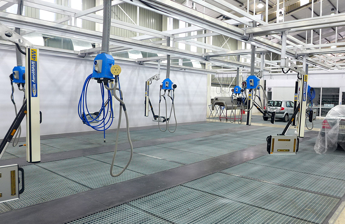 Production preparation area, underfloor extraction, overhead infrared curing and fixed hanging workstation.