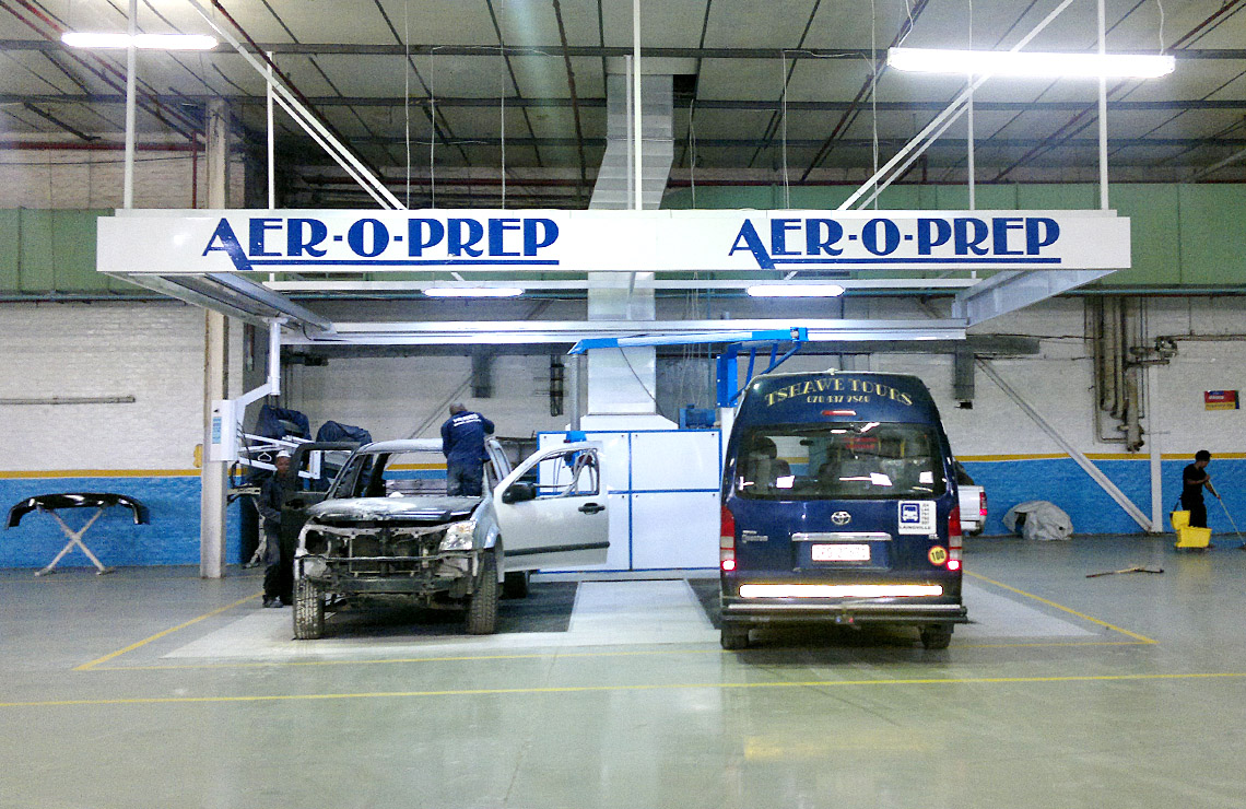 Double preparation bay, comprising of 1 overspray extraction unit, grids for underfloor extraction for 2 cars, 1 Aer-o-vac centralised dry vacuum system with double workstation on a 6m swinging arm